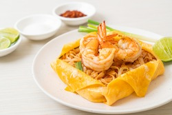 Thai stir fried noodles with shrimps and egg wrap (Pad Thai) - Thai food style