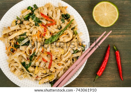 Thai Style Chicken Pad Thai With Noodles On A Green Wooden Background #743061910