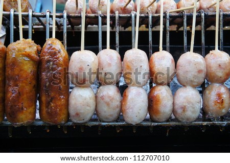Thai Style Grilled Hot Dog on Street Market in Thailand
