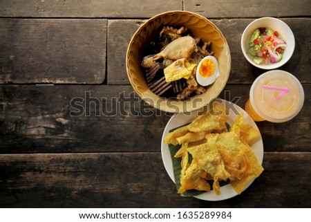 Thai style noodle with Chicken Drumsticks, Thai Noodle and egg - Pork blood congeale, Thai Fried dumplings, Thai Noodle on wood background.