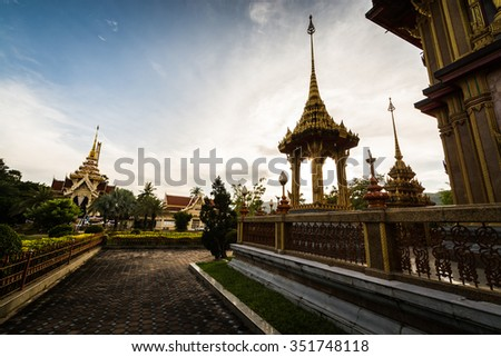 Thai style outdoor architecture with sculpture under sunlight in chalong temple, Phuket, Thailand