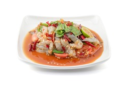 Thai Style spicy seafood salad with shrimps isolated on the white background with clipping path.