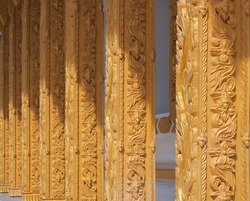 Thai style stucco, church pillars in a Thai temple