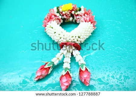 thai style white and red flower garland