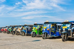 Thai Taxi or Tuk Tuk is a well known local transportation in Thailand.  Tuk Tuk are famous transportation for Traveller in the city