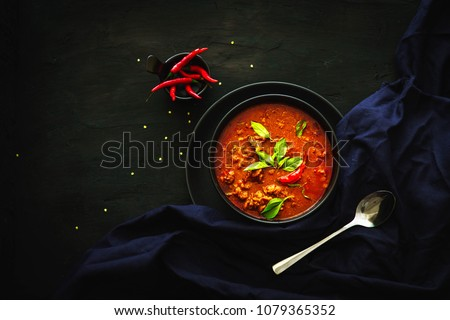 Thai traditional food, Red curry, spicy soup, dark food photography
