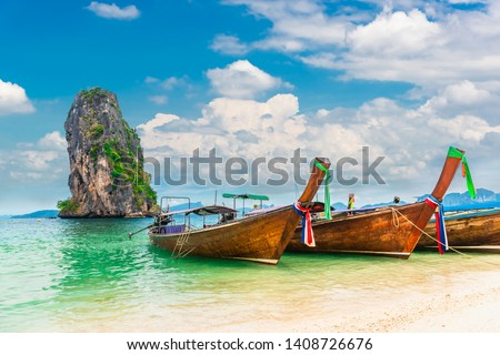 Thai traditional longtail boat on natural sea beach waiting for traveler, Ao Nang beach Krabi, Landmark tourist travel Phuket Thailand summer holiday vacation trips, Tourism beautiful destination Asia #1408726676
