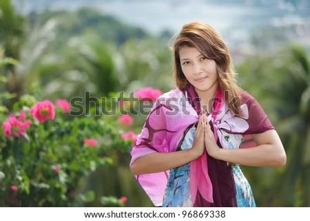 thai woman greetings sign in ko phi phi island, thailand