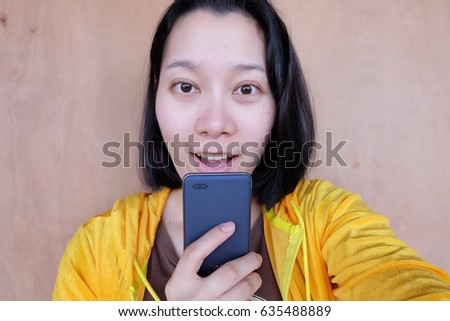 Thai woman texting on the phone #635488889