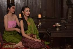 Thai women wearing traditional costumes in ancient times During the Ayutthaya period Was in a Thai house in the Siam era, in the Ayutthaya period According to the culture of that era Sharp face, beaut