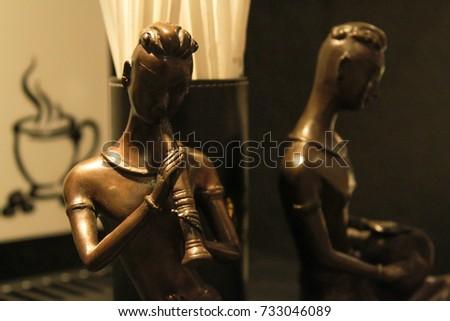 thai wooden doll in coffee corner in hotel. #733046089