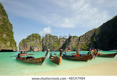 Thailand. Andaman sea. Phi Phi island. Thai boats on Maya bay lagoon