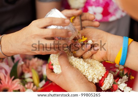 THAILAND - APRIL 11: Thai people celebrate Songkran (new year / water festival: 13 April) by giving garlands to their seniors and asked for blessings on April 11, 2012 in Nakhonratchasima, Thailand.