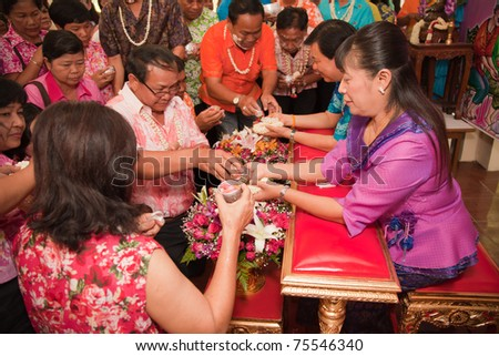THAILAND - APRIL 13: Thai people celebrate Songkran (new year / water festival) by giving garlands to their seniors and asked for blessings on April 13, 2011 in Nakhonratchasima, Thailand.