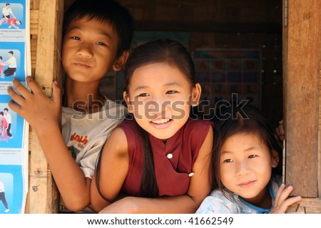 THAILAND - AUGUST 18: Children of ethnicity in school Padang, Padang women are known as giraffe women and their origins are Burmese, August 18, 2005 in Mae Hong Son, Thailand