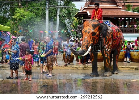THAILAND-Ayutthaya-13 April 2015 Thai elephant is playing with people on street during Songkran Thailand's New Year festival. #269212562