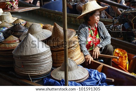 Thailand, Bangkok, Floating Market, Thai hats for sale on a boat