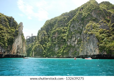 Thailand bay surrounded by green cliffs - stock photo