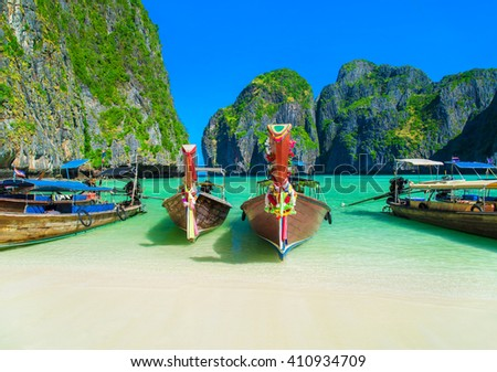 Thailand beach seascape with ring of steep limestone hills and traditional bright longtail boats parking, Maya Bay, Ko Phi Phi Lee island, Phi Phi archipelago, part of Krabi Province, Andaman Sea