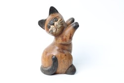 Thailand carved wooden cats on a white background.