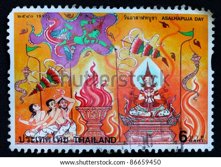 THAILAND - CIRCA SEPTEMBER 1997: A postage stamp printed in Thailand shows image of Thai Asalhapuja Day, Public Holiday in Thailand circa 1997