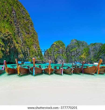 Thailand exotic beach view at ring of steep limestone hills with many traditional longtail boats parking, Maya Bay, Ko Phi Phi Lee island, Phi Phi archipelago, part of Krabi Province, Andaman Sea