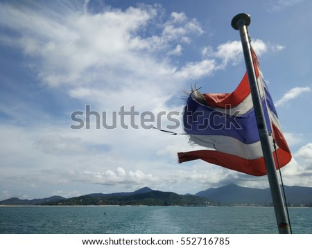 Thailand flag behide on the both and blue sky. see Phra Ngan Island,south of Thailand