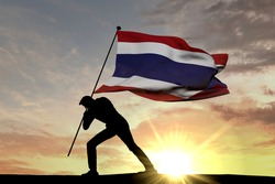 Thailand flag being pushed into the ground by a male silhouette. 3D Rendering