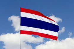 Thailand flag isolated on the blue sky with clipping path. close up waving flag of Thailand. flag symbols of Thailand.