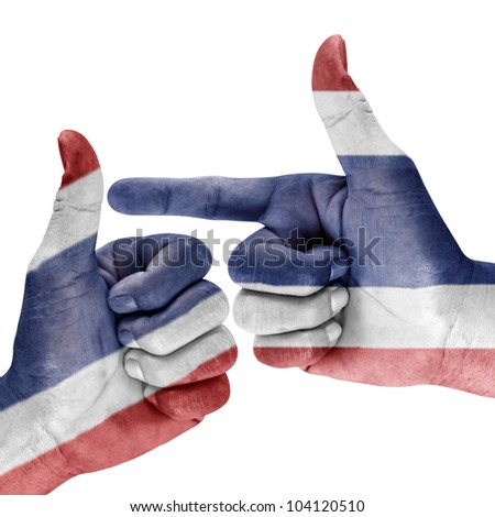 Thailand flag on hand with thumbup and shooting gesture on white background.