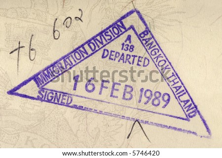 Thailand immigration stamp or travel permit on the inside page of an official identity document