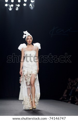 THAILAND -MAR 27 : A model is walking the runway at K and I collection presentation for Fashion Networking during Bangkok International Fashion Week 2011 on March 27, 2011 in Bangkok,Thailand
