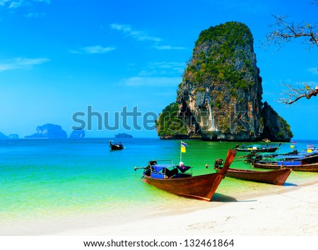 Thailand ocean beach Thai journey scenery landscape with wooden boats blue sky and clear sea water