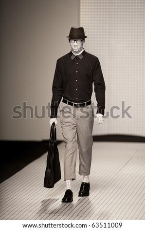 THAILAND -OCT 21 : A model is walking the runway at Greyhound collection presentation for Autuwn/Winter 2011 during Bangkok International Fashion Week 2010 on October 21, 2010 in Bangkok,Thailand