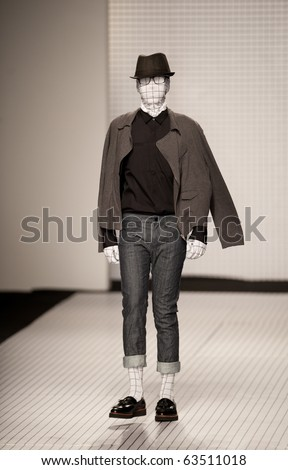 THAILAND -OCT 21 : A model is walking the runway at Greyhound collection presentation for Autuwn/Winter 2011 during Bangkok International Fashion Week 2010 on October 21, 2010 in Bangkok,Thailand - stock photo