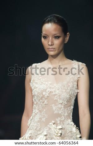 THAILAND - OCT 21 : A model is walking the runway at Kai collection presentation for Autumn/Winter 2010 during Bangkok International Fashion Week 2010 on October 21, 2010 in Bangkok,Thailand