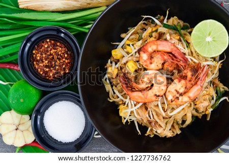 """Thailand or asia food Fried rice Noodles and shrimp """"Pad Thai""""with and vegetables in black dish on background. #1227736762"""