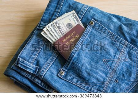 Free Thailand passport in jeans pocket Photos | Avopix.com