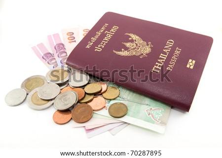 Thailand passport and Thai money on white background