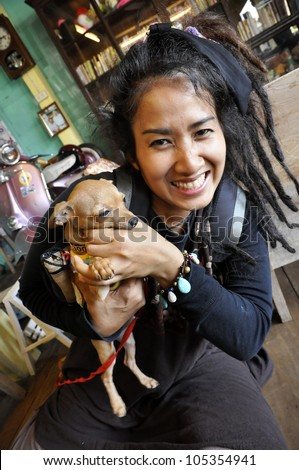 Thailand Reggae Women Carry Small Chihuahua