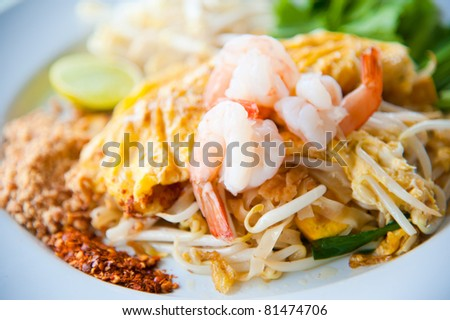 Thailand's national dishes, stir-fried rice noodles with egg, vegetable and shrimp (Pad Thai)
