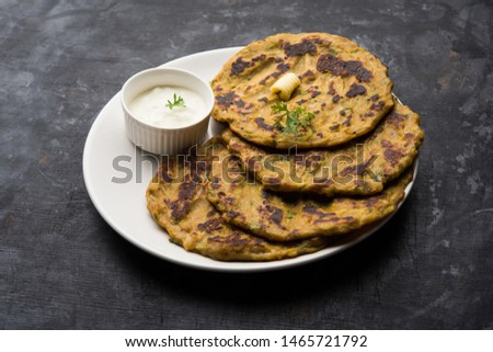 Thalipeeth is a type of savoury multi-grain pancake popular in Maharashtra, India served with curd/butter or ghee
