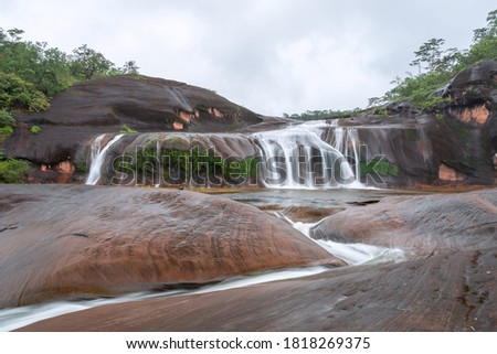 Tham Phra Waterfall,Beautiful waterfall in Rain forest at  Bueng Kan Province,Thailand  Stockfoto ©