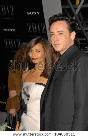 "Thandie Newton and John Cusack  at the premiere of '2012,"" Regent Cinemas L.A. Live, Los Angeles, CA.  11-3-09"