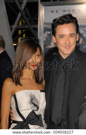 "Thandie Newton and John Cusack at the premiere of '2012,"" Regent Cinemas L.A. Live, Los Angeles, CA.  11-3-09 - stock photo"