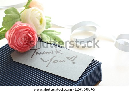 thank you card with blue gift box and flower bouquet