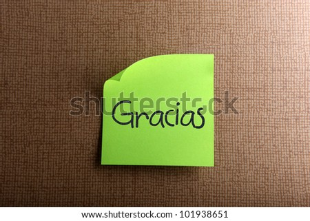 Thank you - colorful sticky notes with handwriting on cork bulletin board.