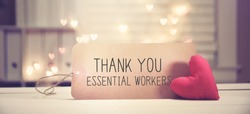 Thank You Essential Workers message with a red heart with heart shaped lights