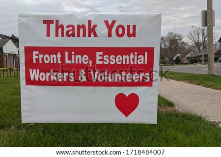 Thank you front line, essential workers & volunteers sign in front of a house during corona virus pandemic outbreak quarantine. Emergency workers, first responders, health care workers appreciation.