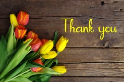 Thank You Message, Colorful tulips on wooden background. Spring flower background with blooming tulips, mockup template with copy space, backdrop for seasonal greeting card celebration. Women's Day.